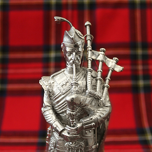 "Silver Plated 8.5"" Scots Guard Piper statue on wooden plinth"