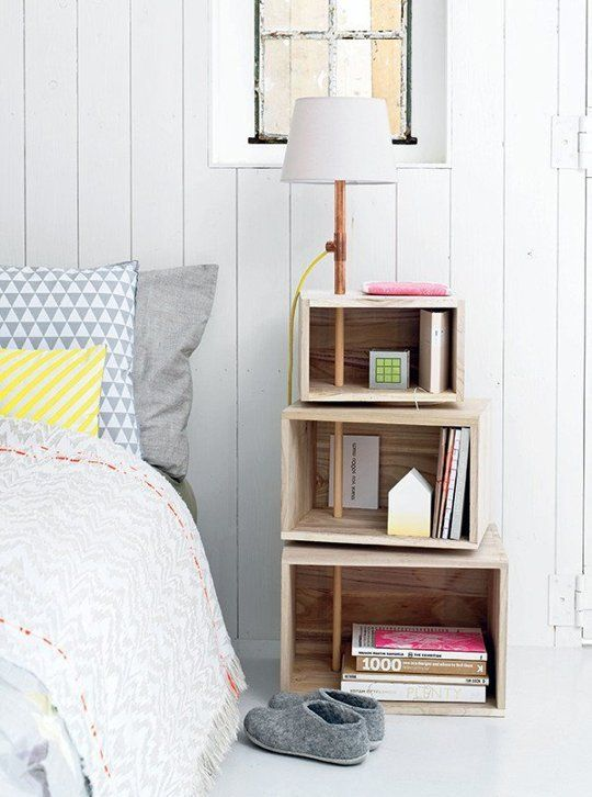 Stack of boxes used as bedside table