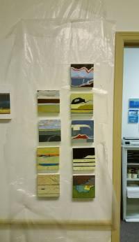 "Grid of 6"" x 6"" paintings on studio wall."