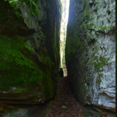 Looking down a narrow crevice between two massive (house-sized) boulders in Little Rock City