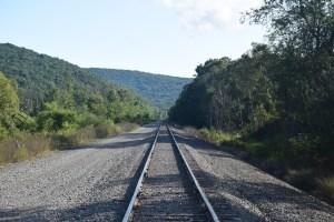 Looking north-east down a set of railroad tracks on Sawmill Run Rd