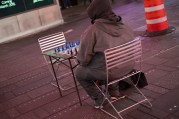 Time Square - someone waiting to play chess.