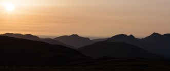 Sun setting over the Arrochar Alps, from the Luss Horseshoe.