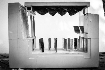 Section model of the main room showing the rough concrete wall to the left , the sand wall to the right and the maze of rotating mirrors on the floor below.