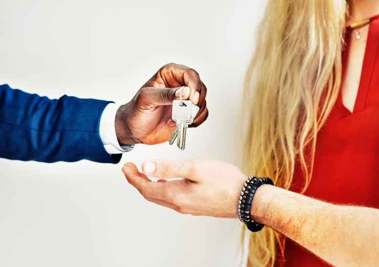 person handing keys