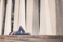 man sleeping on the pavement