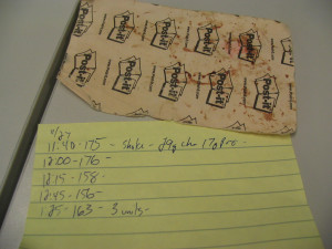 a post it note bg log with blood spots on it