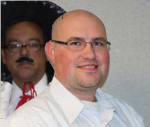 Picture of Scott with George, wearing a mariachi hat & fake mustache behind me