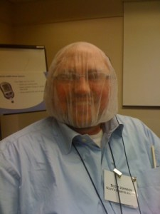 Scott with a hair net over his entire head