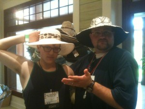 Picture of Sam & I trying on goofy beach hats in the gift shop