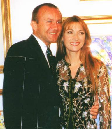 John standing next to Jane Seymour as they host a party together.