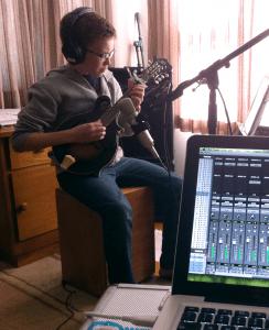 candid shot of David recording mandolin