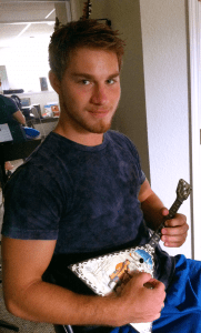 photo of Luke playing a balalaika
