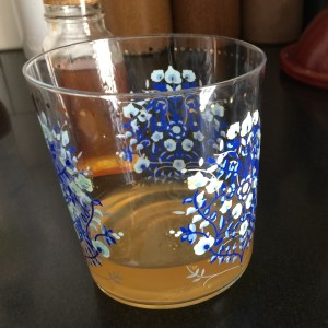 drinking glass containing some apple cider vinegar