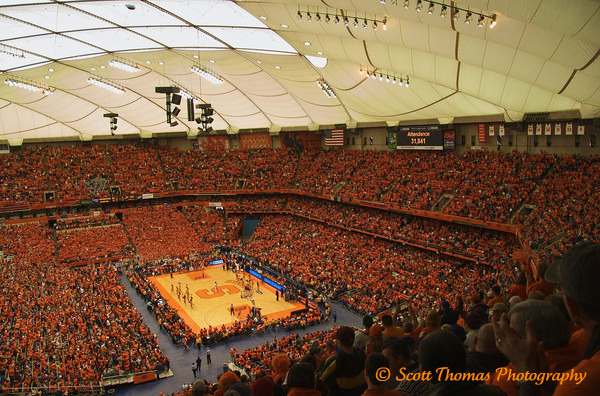 31,841 mostly Orange-clad people attended the Big East Mens Basketball game between the Syraucse University Orange and the Georgetown Hoyas on Saturday, February 14, 2009.