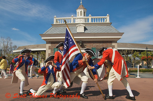 The Spirit of America Fife and Drum Corps saluting the US Marine Corps in front of the American Adventure pavilion in Epcots World Showcase.