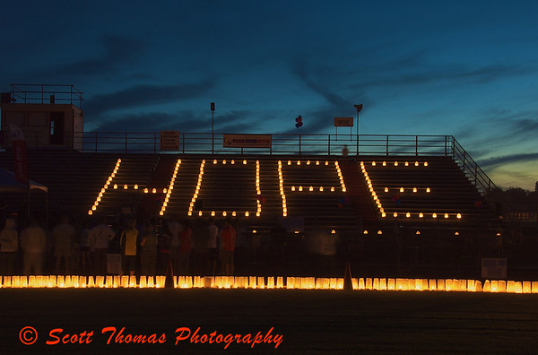 Luminaries spell out Hope on the bleachers of the Pelcher-Arcaro Stadium as the walkers stop for the luminaria service which celebrates cancer survivors during the Baldwinsville, New York, Relay for Life Cancer fund raiser on Friday, June 19, 2009.