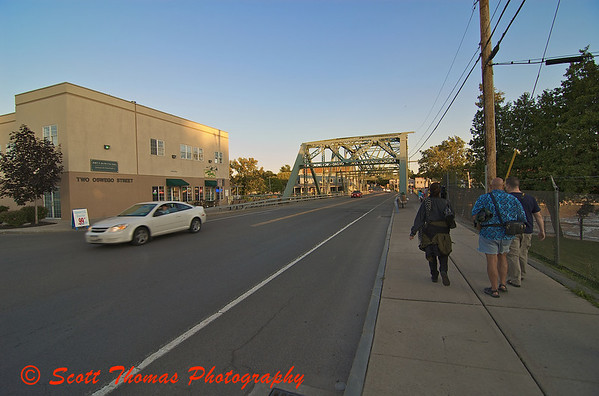 Heading for a sunset, members of the Syracuse Photographers Association walk towards the Seneca River.