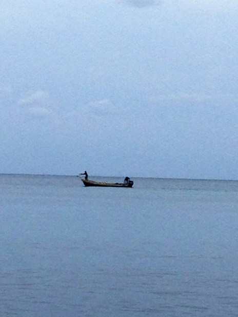 Local fisherman take their boat out onto the Caribbean Sea