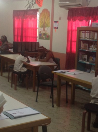 A Peace Corps Trainee conducts thee ECBLA with a student from Desruisseaux Combined School