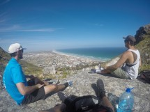 Myself, Kevin Wang, and Don Nguyen stopped to rest during hike to the top of a mountain overlooking Muizenberg on our first day together in South Africa.