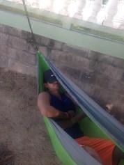 Kevin Wang naps in his hammock set up at BBC Beach.