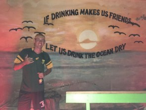 Myself in front of a mural at BG's Bar in Grenville.