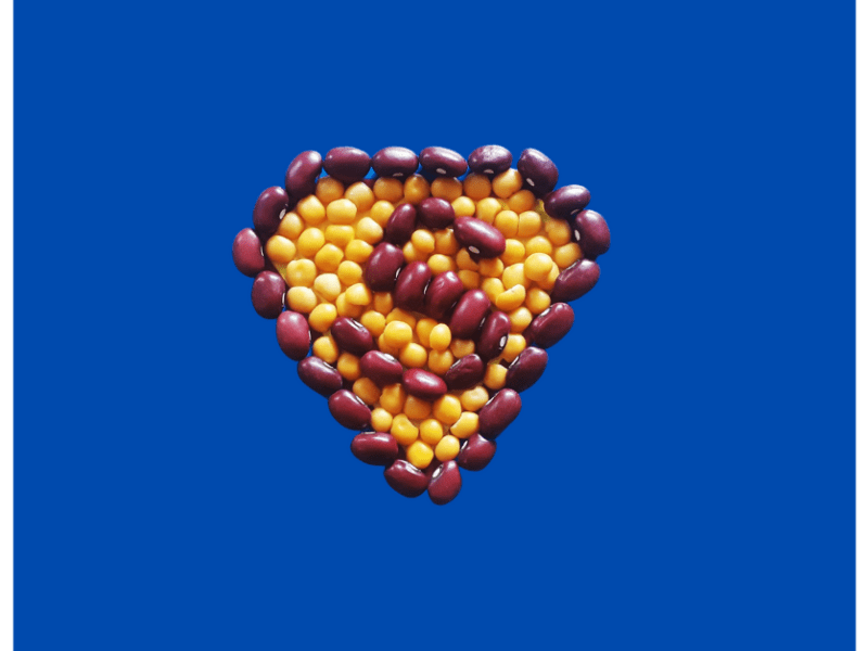 Red beans and yellow peas arranged in a superman configuration