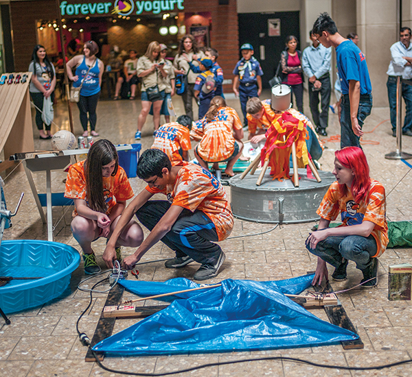 Local Venturers set up a display to help welcome and celebrate the opening of Discovery Outpost at the Woodfield Mall.