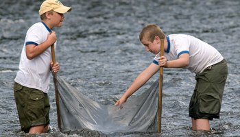 Scouts working on project in water