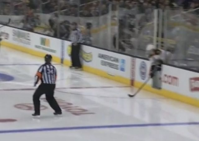 Bruins' Hamilton Plays Puck from Penalty Box