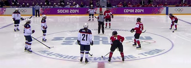 Referee Joy Johnston prepares for the opening faceoff of the 2014 Olympic Gold Medal game