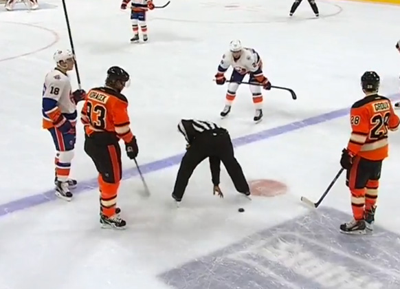 Flyers' Voracek Plays Keep-Away with Linesman Shandor Alphonso