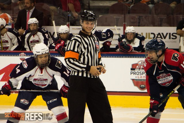 Referee Lucas Martin prepares for the opening draw of the third period of the All-American Prospects Game