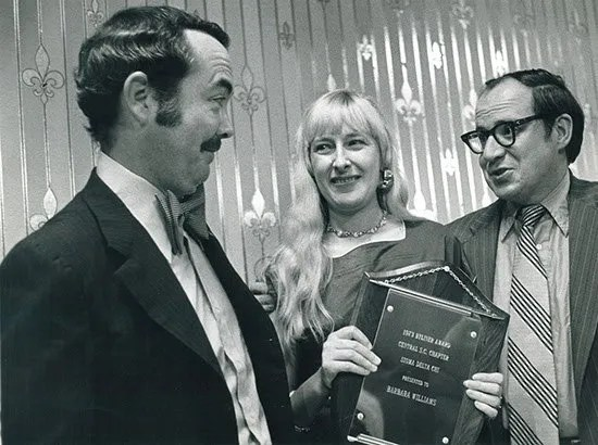 Being presented the 1973 Byliner Award from the Central Chapter Sigma Delta Chi by Columbia radio broadcaster Jay Latham and Kent Krell of The State.