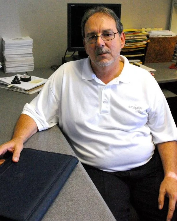 Harter sits at his desk in the Times and Democrat newsroom.