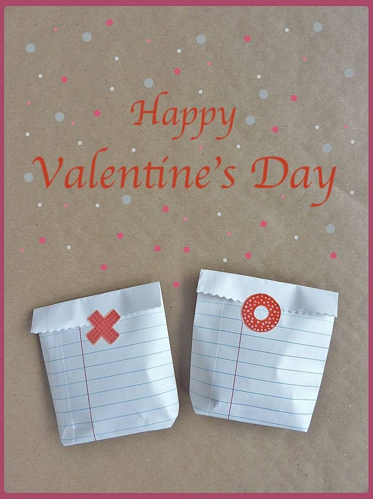 these valentine treat bags are quick simple and inexpensive to make from regular school notebook papers make your own valentines day paper treat bags and