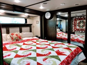Red and Green quilt on a king sized bed