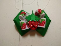 "Strawberry on 5/8"" Strawberry Ribbon, stacked on 1.5"" Emerald Green Boutique Bow"