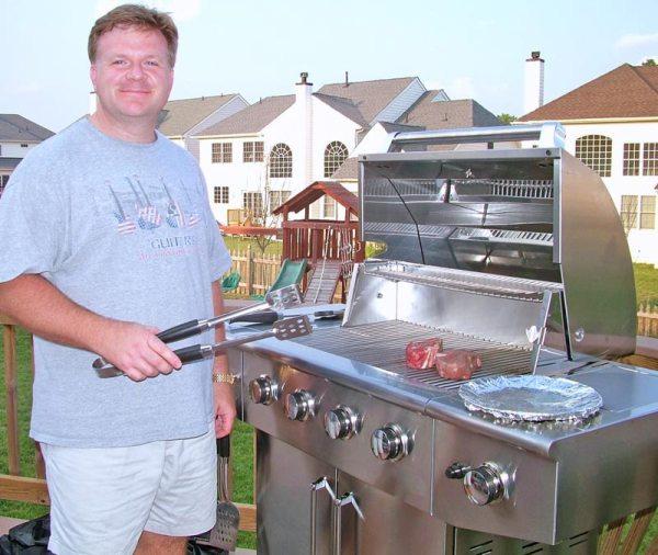 Jason grilling in the backyard.