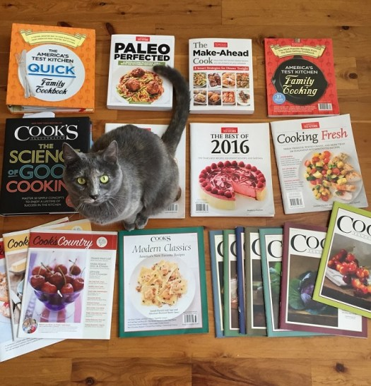 all my ATK cookbooks and our cat, Peach