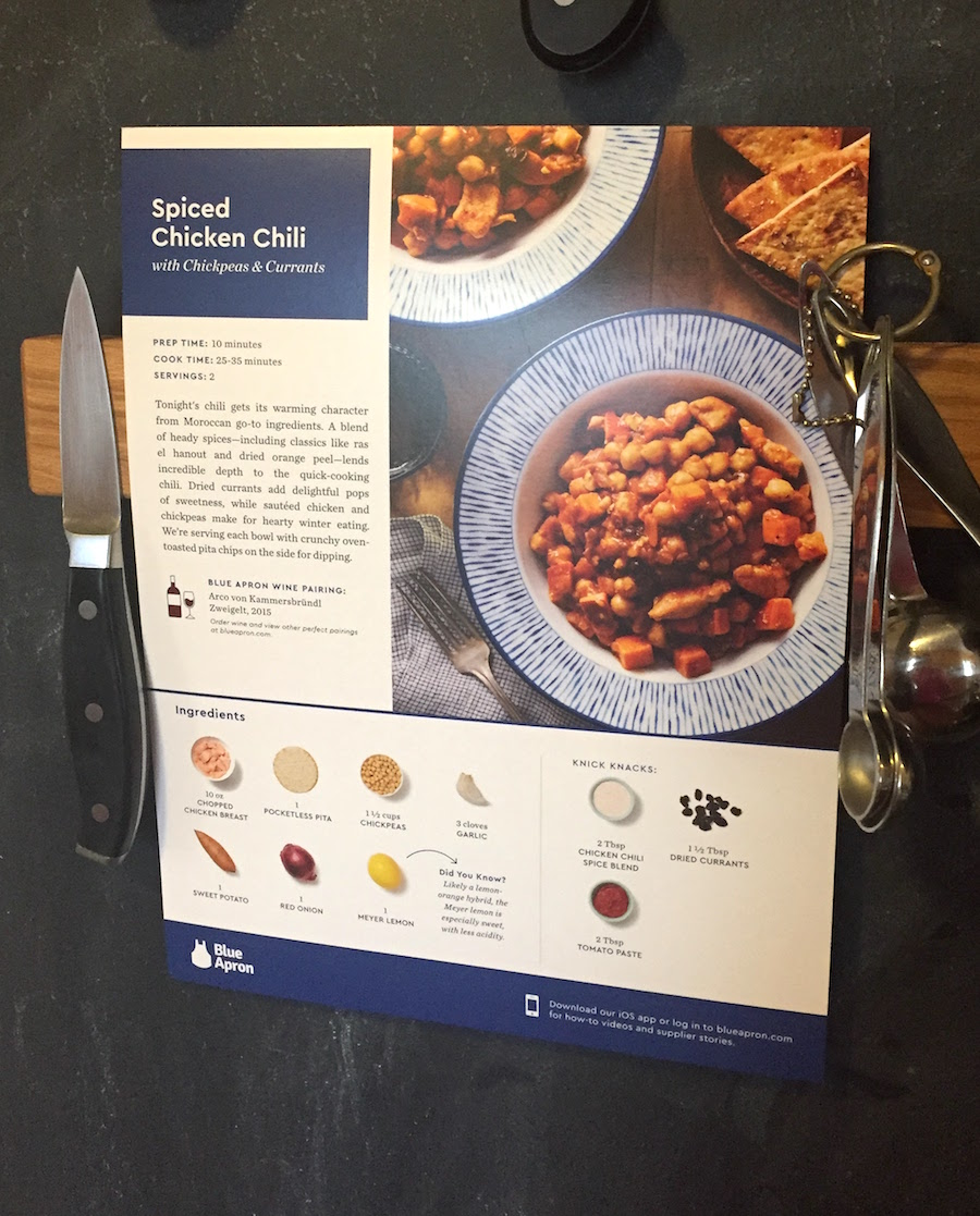 Blue Apron recipe sheet held on a magnetic knife rack