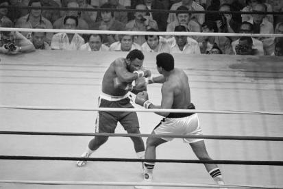 01 Oct 1975, Manila, Luzon Island, Philippines --- Heavyweight champion Muhammad Ali punches Joe Frazier during their title bout in Manila in 1975. --- Image by © Bettmann/CORBIS