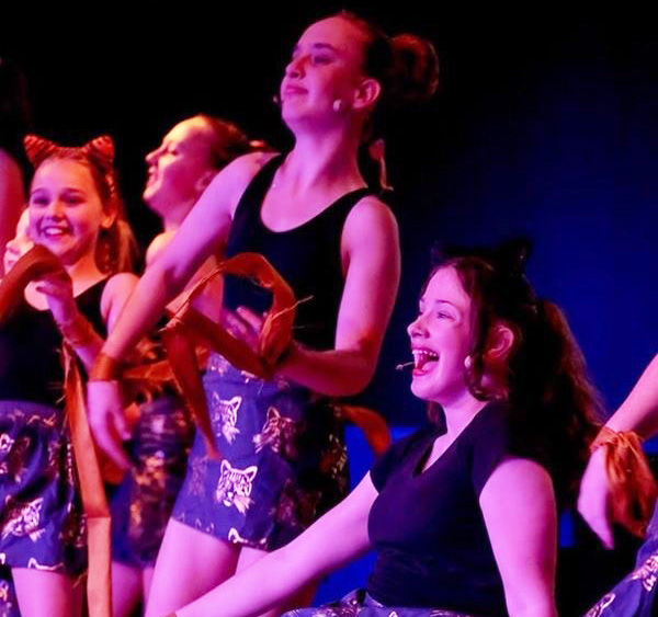 Girls performing at Screech Arts