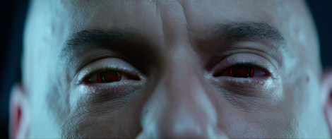 a man's face with red eyes