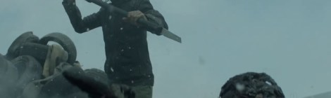 person with stick raised in snow