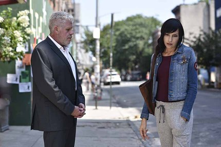 ASHER: Watch This Exclusive Clip With Ron Perlman And Famke Jannsen