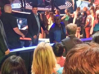 Randy Jackson, former American Idol judge-turned-contestant coach, greets Chef Gordon Ramsay in studio.