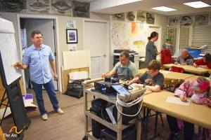 David leading a cartooning class at the Arc of the Capital Area