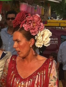 Every thing is done to extremes at the Seville Feria - like this flamenca's three flowers (most women only wear one, or two).